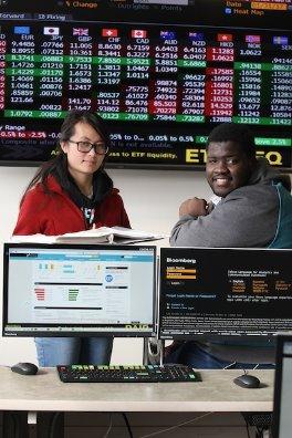 students near stock tickers