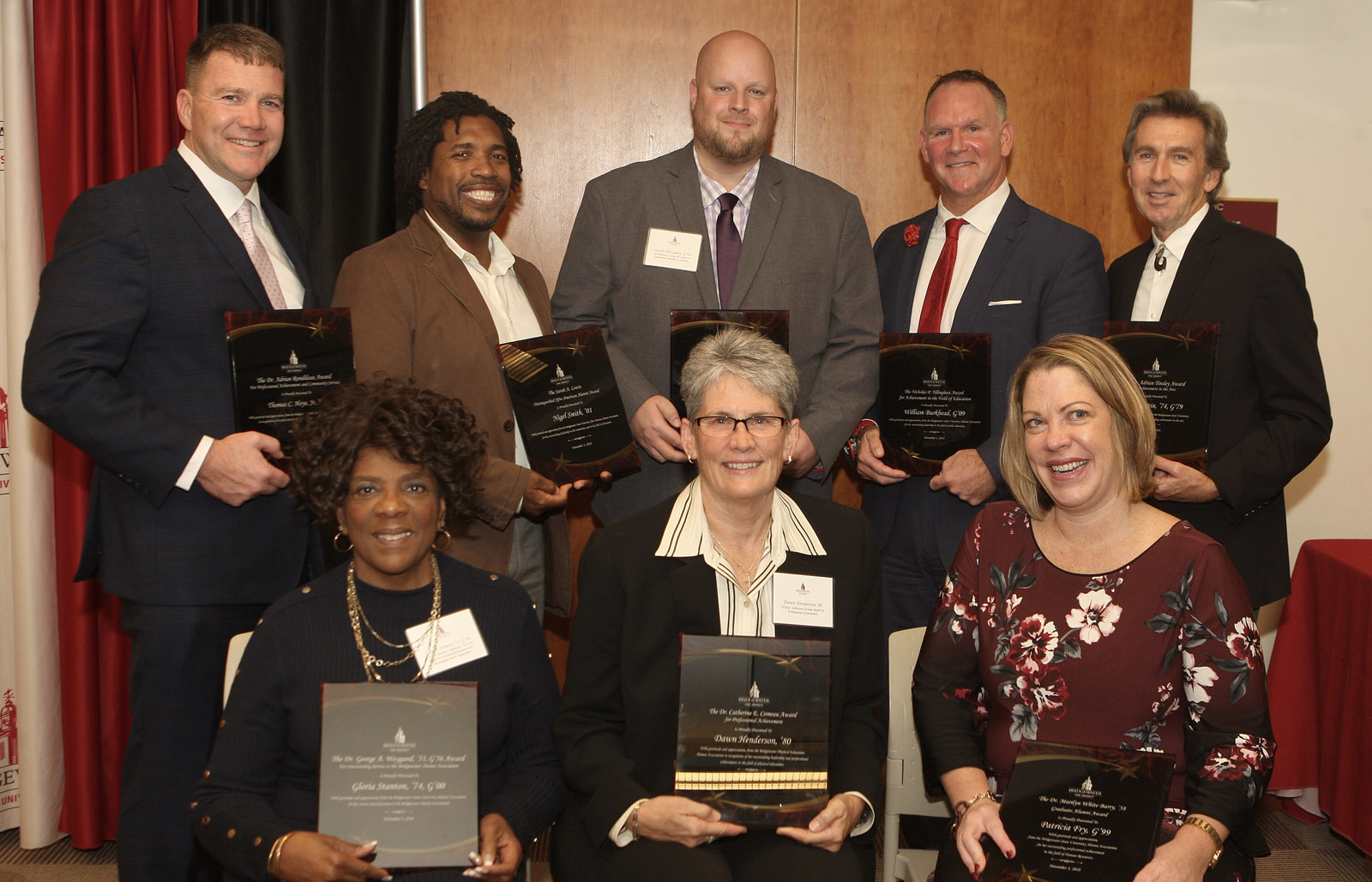 Image of 2018 Alumni Awards Winners holding their award plaques